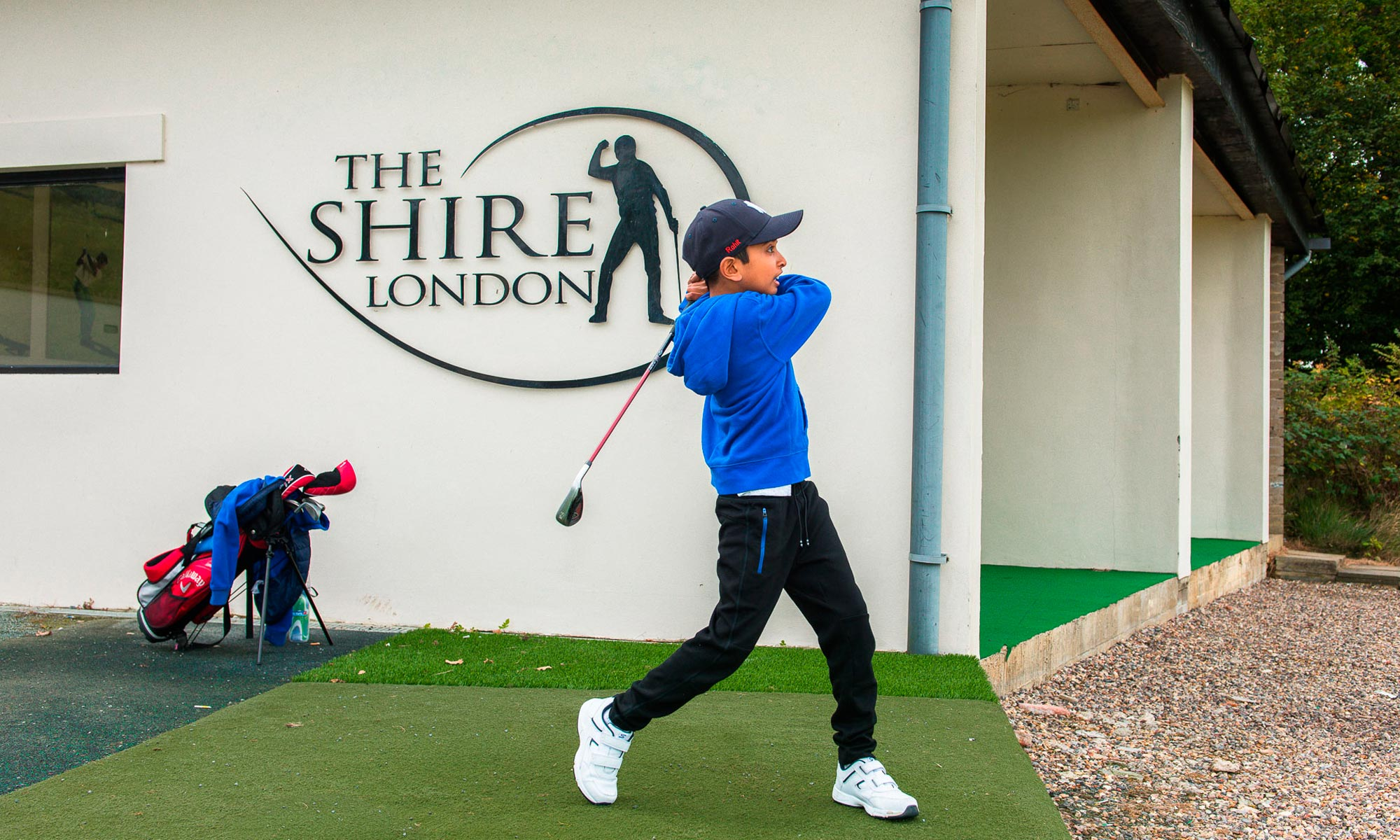Young golfer at the driving range at The Shire London