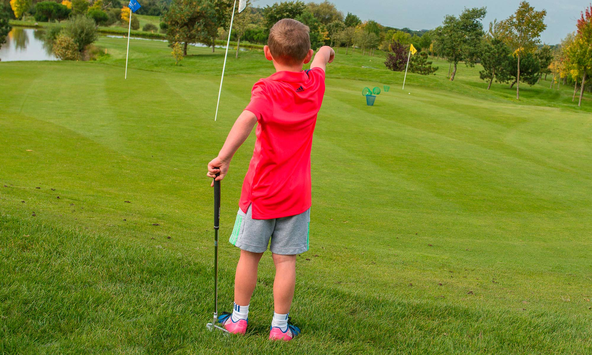 Young boy on the putting green at The Shire London